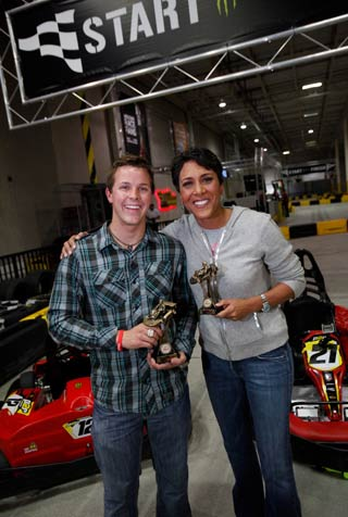 Trevor Bayne and Robin Roberts posing with trophies at Pole Position Raceway New York Jersey City