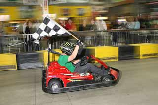 Go Kart Racer With Checkered Flag