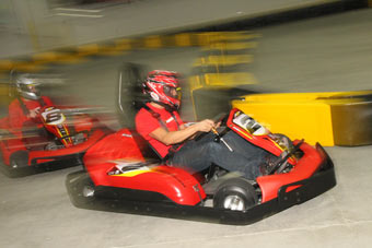 Kart Racers Racing At Pole Position Raceway